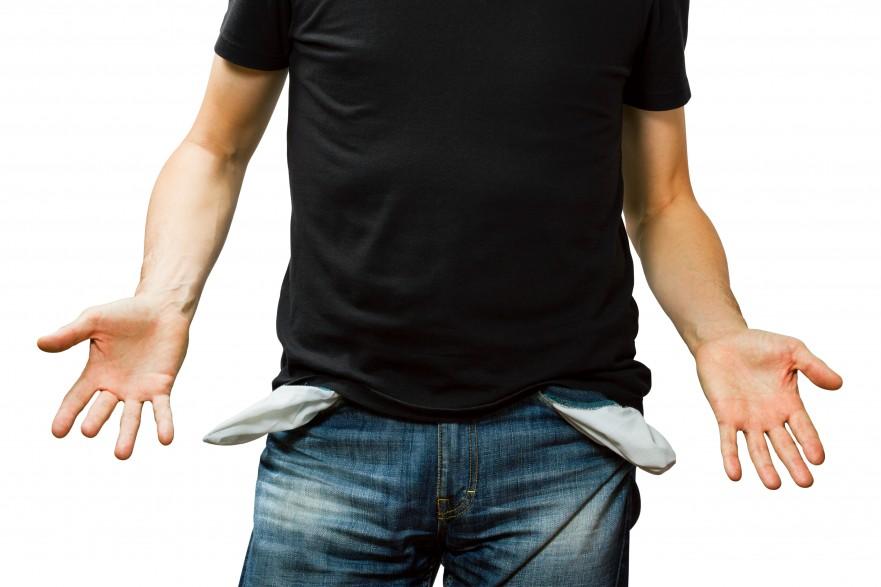man showing his empty pocket, no money